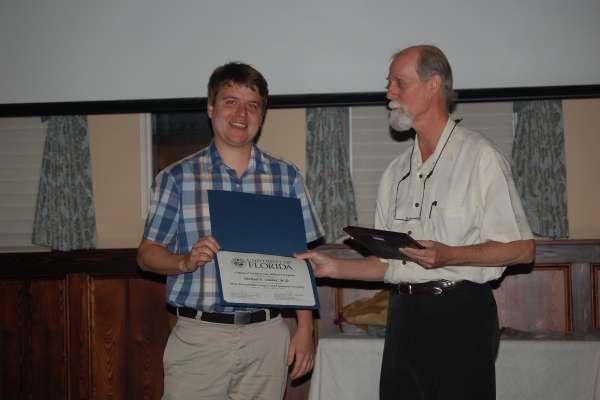 Dr.Osleber receving fellowship certificate