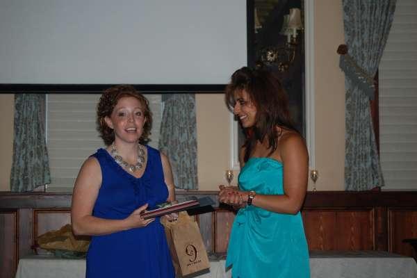 Dr. Kobraei accepts her fellowship certificate