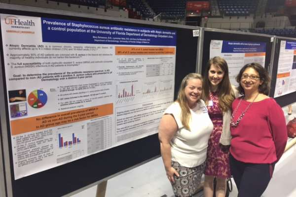 "In the picture, Dr. De Benedetto with our clinical coordinator Mary Bohannon and 4th year medical student Reesa Lendry. In the back ground their posters: ""Prevalence of Staphylococcus aureus antibiotic resistance in subjects with Atopic dermatitis and a control population at the University of Florida Department of Dermatology outpatient clinic"" and ""Atopic dermatitis with an area of sparing at a graft harvest site""."